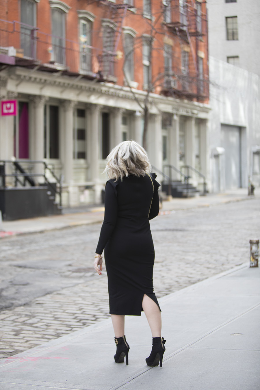 blonde lob haircut and long sleeve black dress