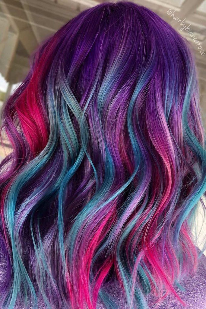Purple Hair with Bright Blue and Pink Highlights