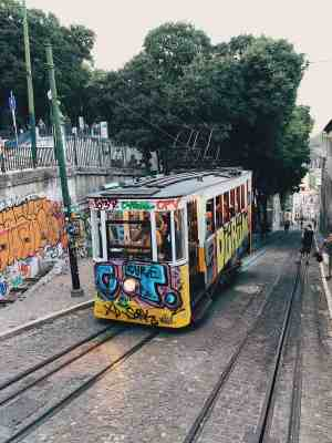 Graffiti cable car coming up the street