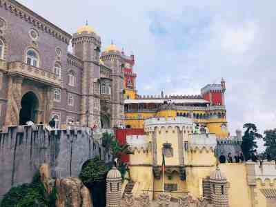 The colorful exterior of Pena Palace in Sintra, one of the top things to do in Lisbon