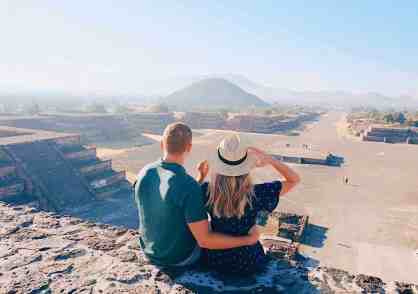 Couple sitting on top of the pyramid of the moon at the Teotihuacan archaeological site, one of the top things to do in Mexico City