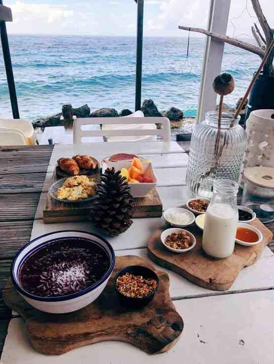 Amazing breakfast spread overlooking the ocean at BijBlauw, one of the best restaurants in Curacao