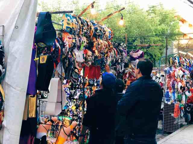 Vendors selling Lucha Libre masks outside Arena Mexico, one of the top things to do in Mexico City
