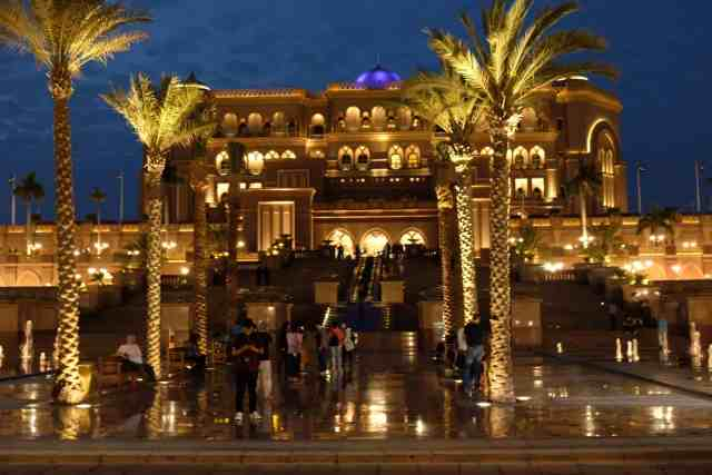 Beautifully lit Emirates Palace in Abu Dhabi