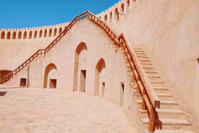 Fort stairs at Nizwa Fort, one of the top things to do in Oman.