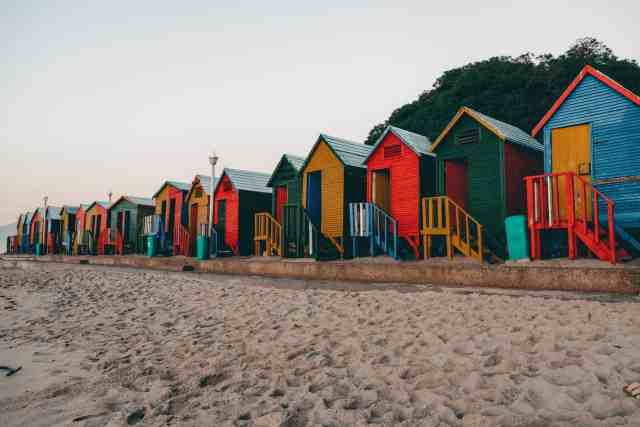 Colorful beach huts lining the St. James Beach