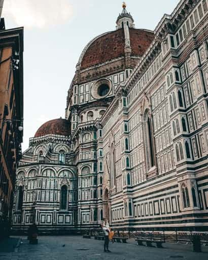 Couple posed in front of the Duomo, one of the best photo spots in Florence