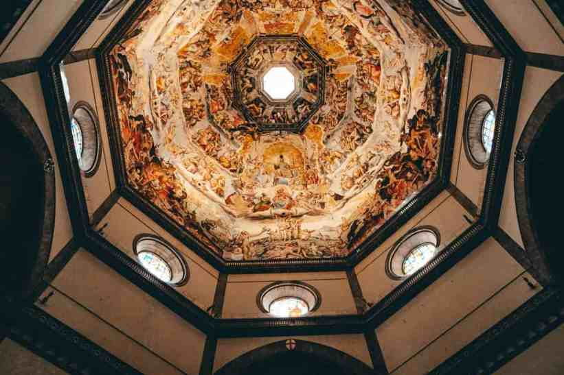 Looking up at the murals in the inside of the Florence Duomo.