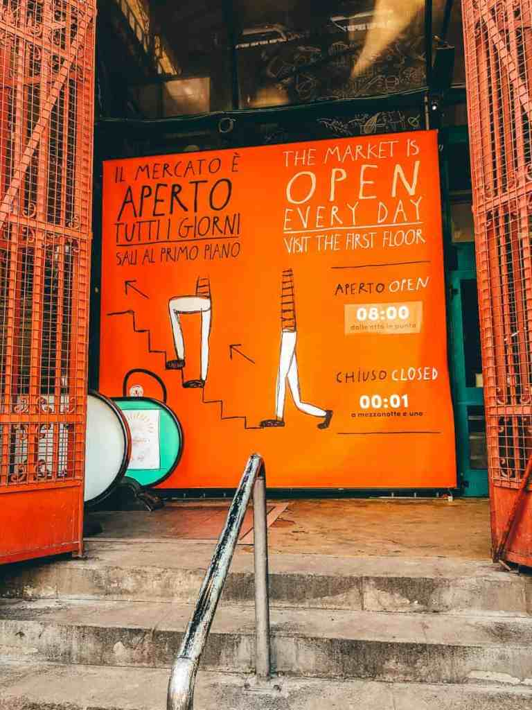 The orange Mercato Centrale welcome sign in Florence.