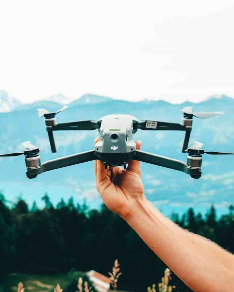 Best drone for travel, DJI Mavic 2 Pro, held out above the Swiss alps