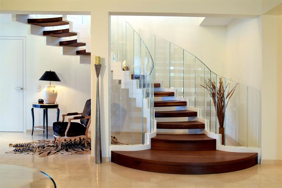 Stylish Staircase Ideas To Suit Every Space Loveproperty Com | Stairs In Middle Of Room Interior Design | 3 Story Staircase | House | Middle Hallway | Private Home | Mixed Interior