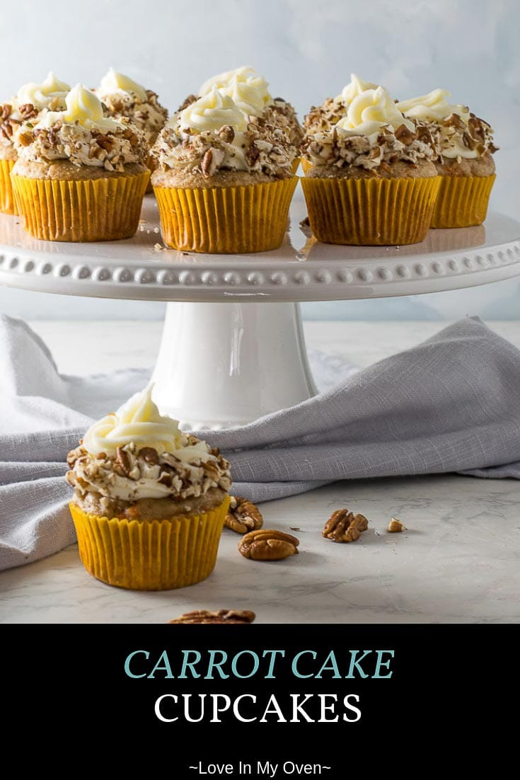 Soft, moist and slightly spiced carrot cake cupcakes swirled with that classic cream cheese icing. The perfect cupcake for any occasion! #carrotcake #cupcakes #easterbaking #carrotcakecupcakes #dessert #springbaking