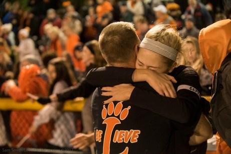 Riley Massey hugs a coach
