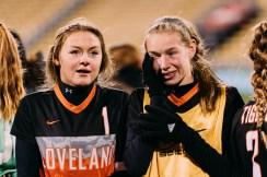 Emily Kubin wipes away tears of joy next to a belary-eyed Jelly Swift