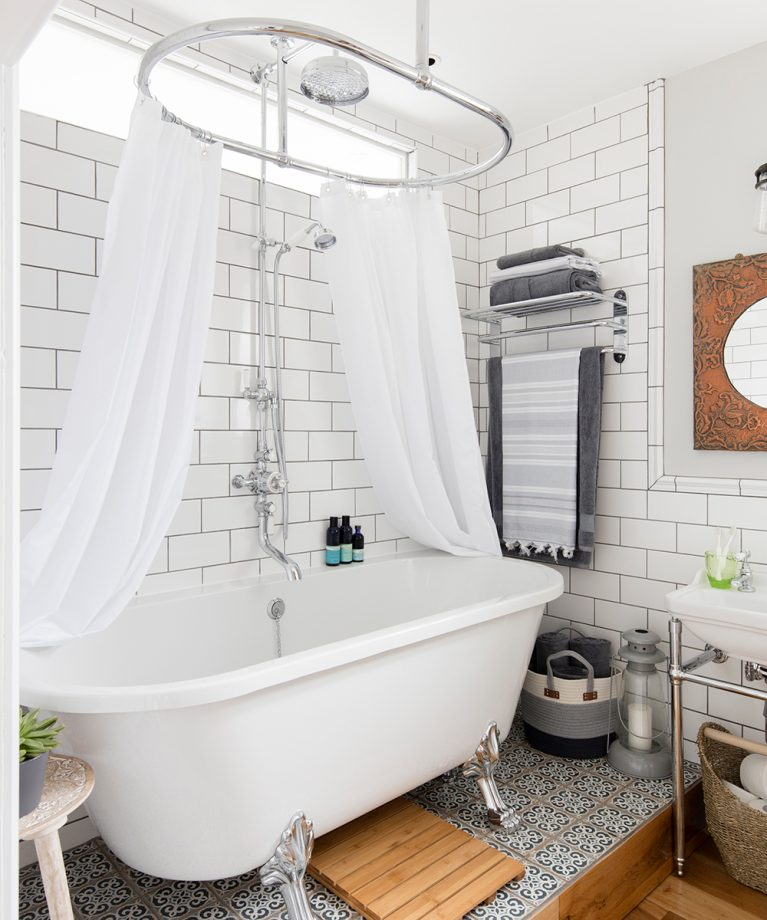 Traditional-double-level-bathroom-makeover-with-rolltop-bath-10-767x920