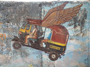 Rickshaw mural in the slums of Mumbai, India