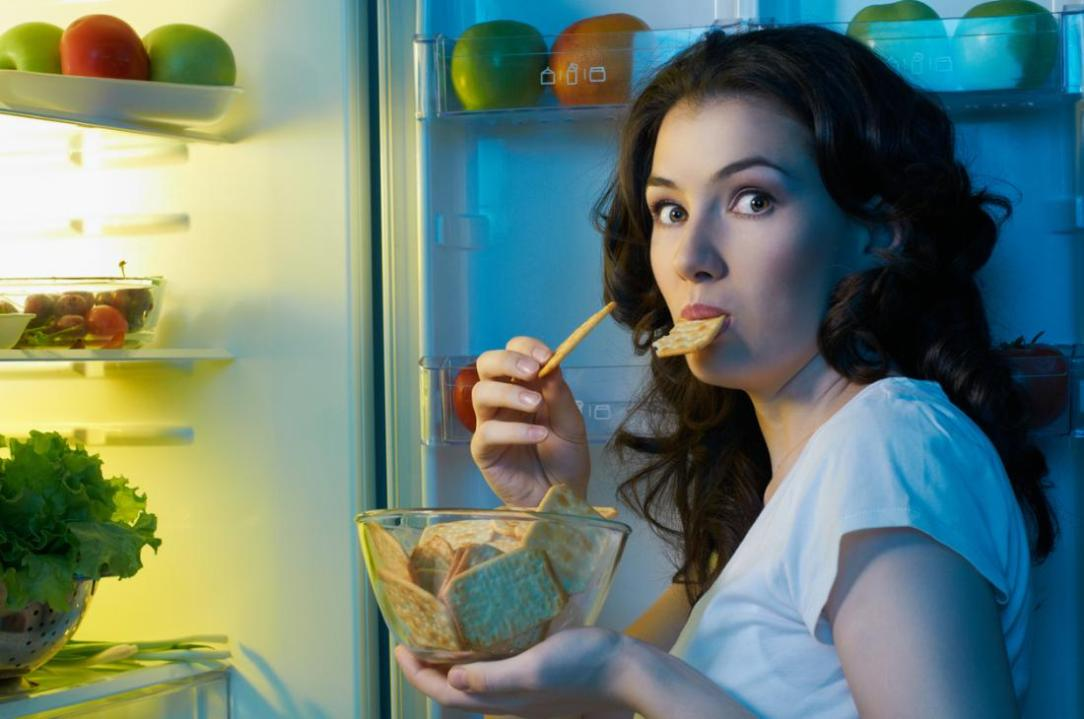 a-woman-having-a-late-night-snack