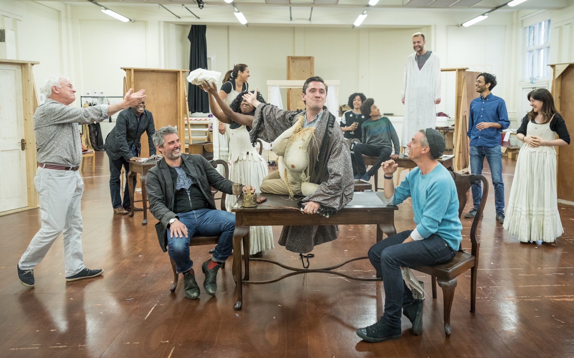 The cast in rehearsals for Queen Anne. Credit Marc Brenner
