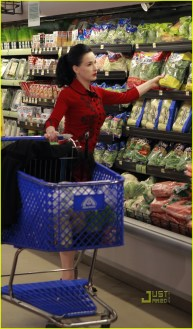 """#7011821 Exclusive...Cointreau spokeswoman and artistic director of Cointreau Prive and iconic burlesque performer Dita Von Teese gets her grocery shopping done in Los Angeles, CA on March 20, 2011. Despite it being pouring rain outside Dita managed to look her best in her signature """"Wheels & Dolls Baby Dita Rose"""" cardigan that she designed herself. Fame Pictures, Inc - Santa Monica, CA, USA - +1 (310) 395-0500"""
