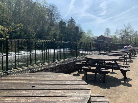 outside seating in Derbyshire. Riverside tables at The Strutt Arms