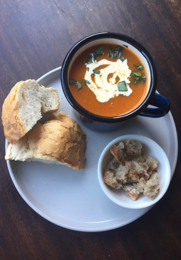 winter warmers Derbyshire - a bowl of tomato soup with bread and croutons