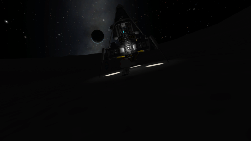 """Landing lights on the Dark Side of the Mun. Kind of pretty, except that the """"empty"""" light on the fuel tank was also illuminated."""
