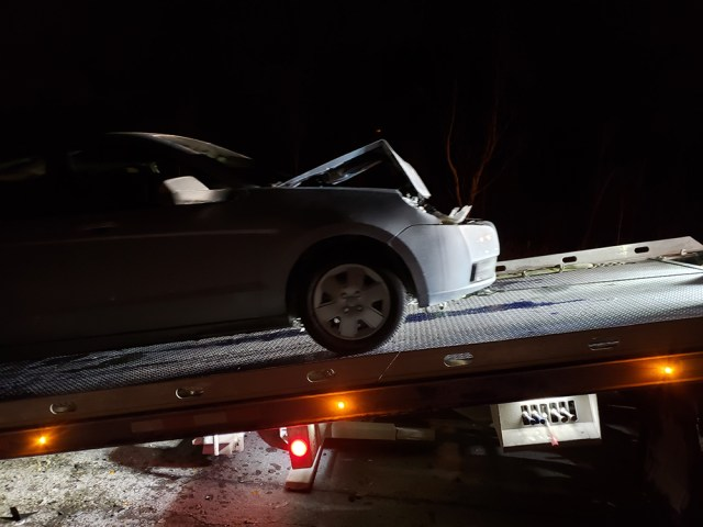 Wrecked car on tow truck