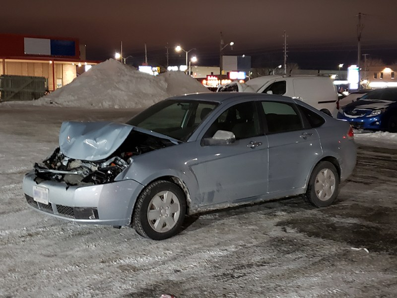 Wrecked car with hood caved in