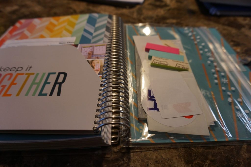 The back of the Erin Life Condren Planner has a pocket folder and a clear ziplock like bag to hold items.