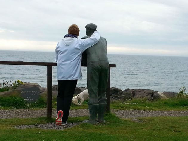 Margaret makes friend with a life sized sculpture. Port William