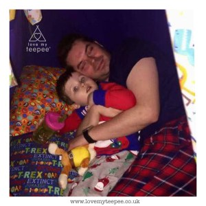 little boy and his dad inside his dinosaur bespoke teepee