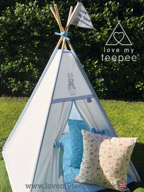 peter rabbit cream kids teepee trimmed in blue and scatter cushions floor mat