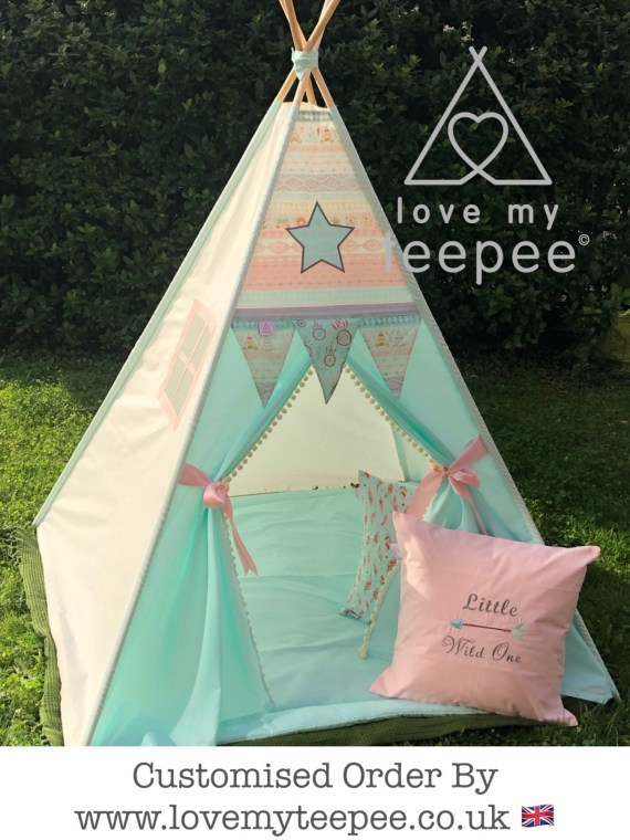 blush pink aztec bohemian dream catcher teepee, mint green floor mat, feathers cushion, pink embroidered with little wild one