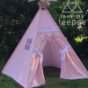 pink teepee tent with white pom poms and lace