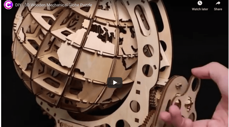 Demonstration of mechanical globe made of wood.