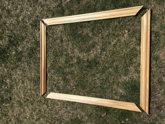 Outline of a frame for a builder grade mirror