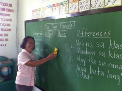 cleaning her new blackboard