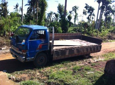 truck delivers blackboard supplies to tanza school