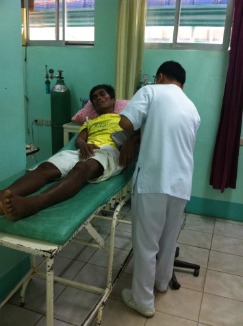 Sancho Trogo has skin ulcers related to the oil spill. He also suffered a stroke and lay on a piece of bamboo for two months praying for help. Now in hospital.