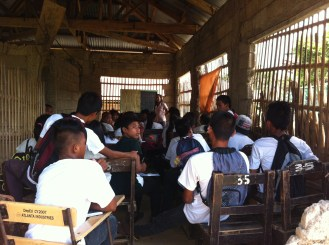As we were leaving I found this group of maybe Year 9 or Year 10 kids attending class in a room with the walls blasted off by SuperTyphoon Yolanda.