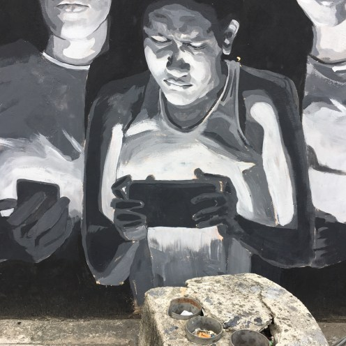Black and White mural of group of millennials with a smartphone