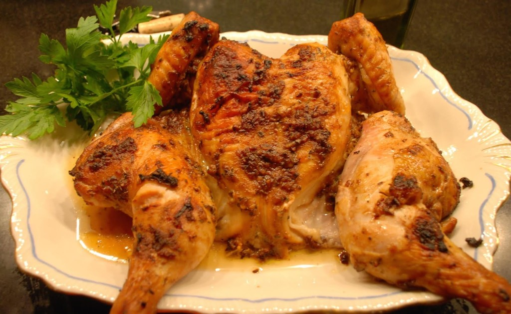 Buttermilk roast chicken on a white platter.
