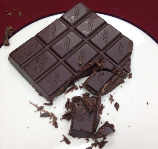 Green & Black's Organic Dark chocolate on a white plate.