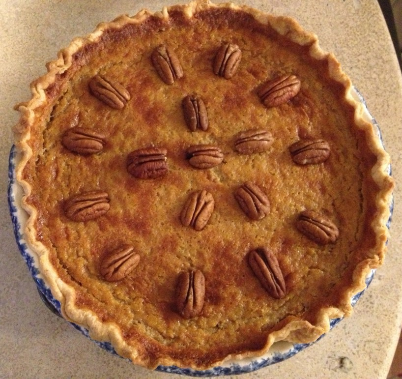 Pumpkin pie with fresh roasted pumpkin and pecan garnish