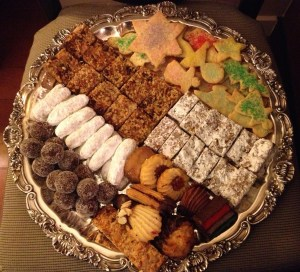 Christmas/holiday cookie platter with Cognac sugarplums, hello Dolly Squares, date bars, sugar cookies, pecan crisps, and special bakery cookies