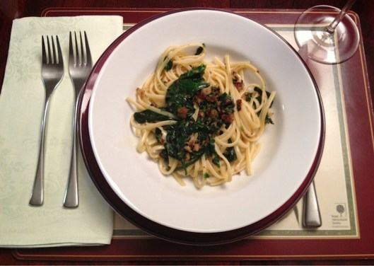 Linguine with olive oil, garlic and spinach topped with broiled breadcrumbs in a bowl, recipe from Union Square Cafe.
