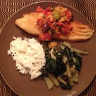 Fried catfish with fennel compote on a brown plate with sauteed Swiss chard and Jasmine rice.