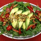 Arugula salad with avocado, grape tomatoes, red pepper and roasted pepitas.