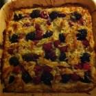 Coconut, raspberry, blackberry tarte in a Le Creuset pan.