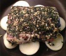 Herb, garlic and olive oil marinade on a pork loin roast in a ziplock bag.